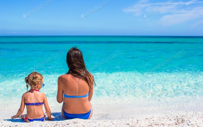 Young mother and adorable little girl during summer vacation