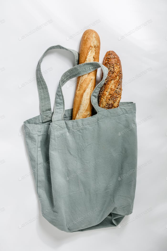 Fresh  baguette in cotton bag. Bakery Products. Friendly packaging.