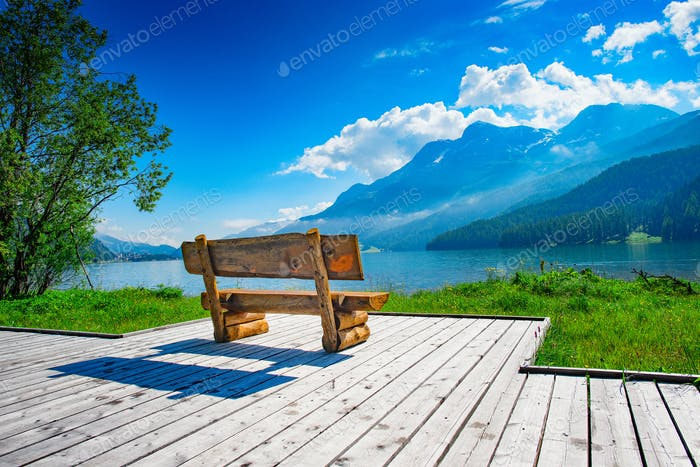 Bench with view of the mountain lake