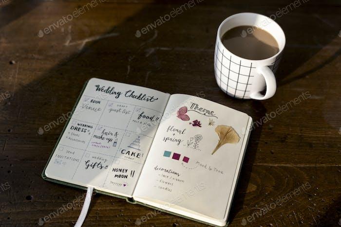 Closeup of wedding checklist notebook on wooden tabel