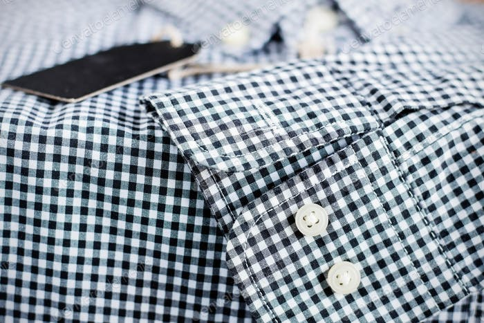 Button and surface of shirt.