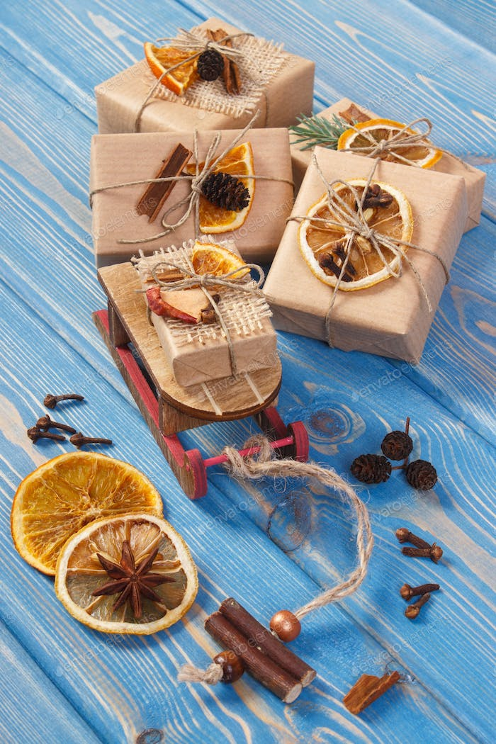 Wooden sled, wrapped gifts with decoration for Christmas or other celebration