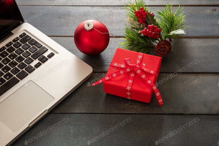 Christmas, office closed. Laptop and xmas decoration, blue background