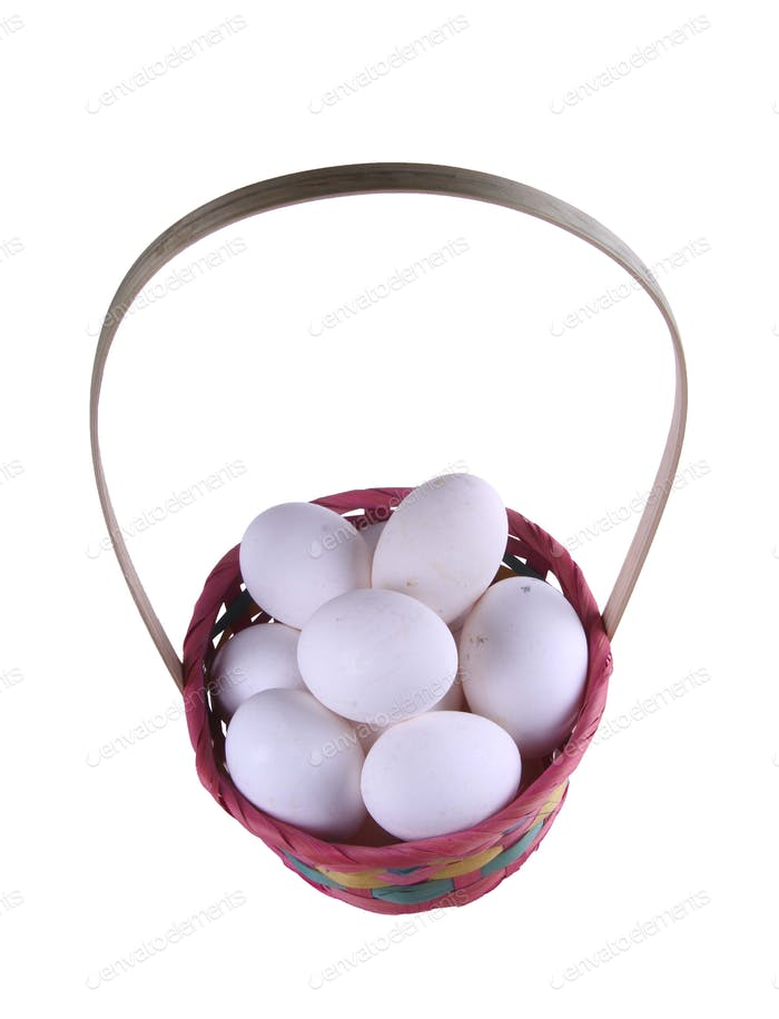 Eggs in a straw basket isolated