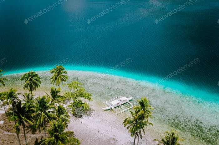 El Nido, Palawan, Philippines. Aerial drone view of tourist island hopping boats moored at tropical