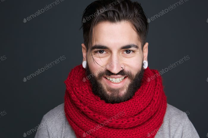 Smiling man with beard and red scarf