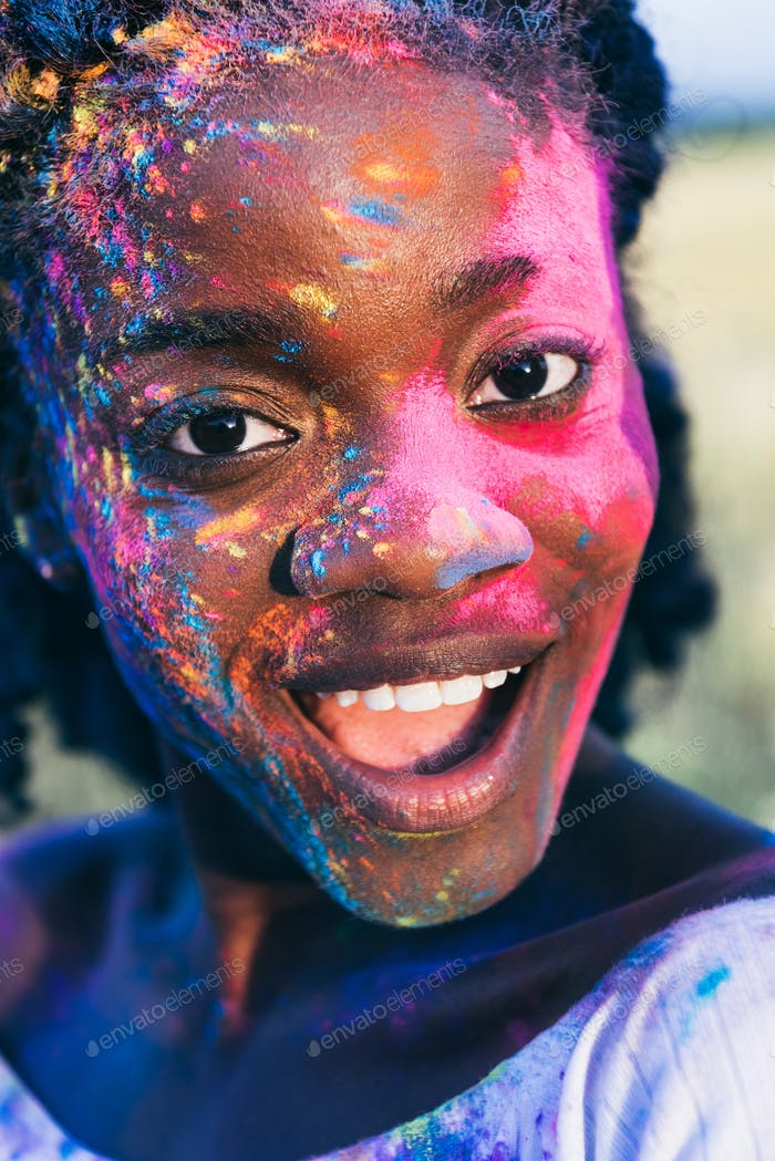 African American Girl With Colorful Paint on Face