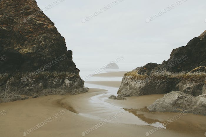 Rock formations on beach at low tide, Arcadia Beach State Park, Oregon
