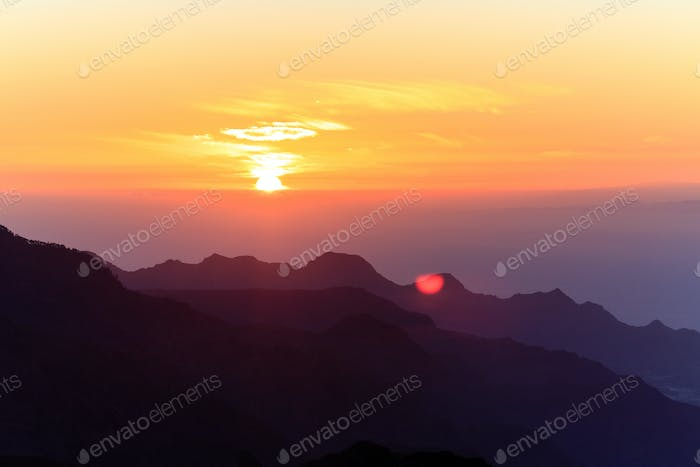 Mountains inspirational sunset landscape, islands and ocean