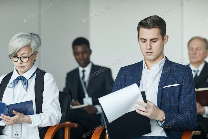 Business people sitting at seminar