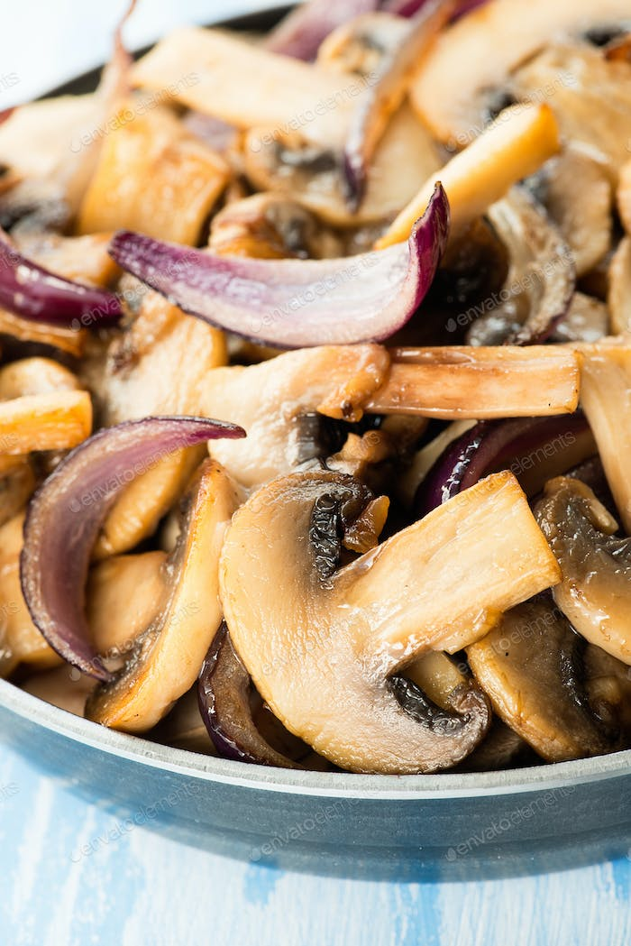 Sauteed button mushrooms in skillet