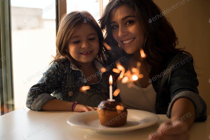 Mom and daughter celebarting birthday