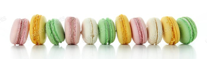 Multicolored tasty macaroons isolated on white background