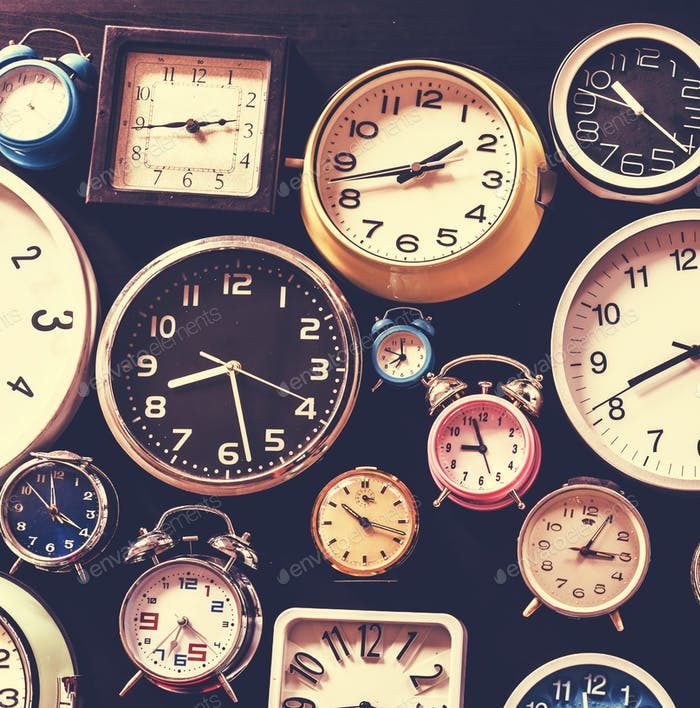 Closeup of various clocks isolated on black
