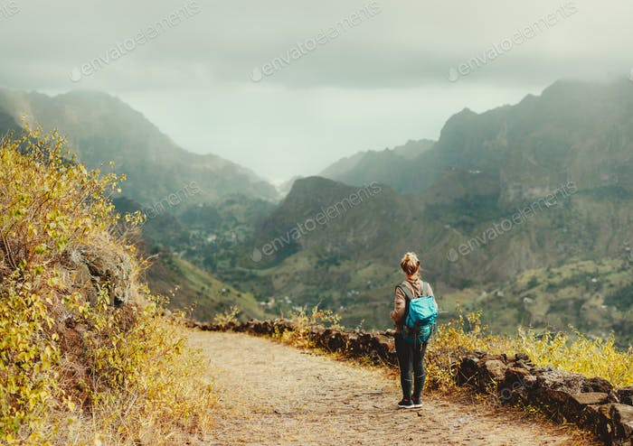 Santo Antao Island Cape Verde. Female tourist with backpack enjoying hiking path route to Paul