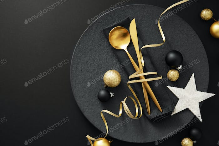 Gold cutlery served on plate for Christmas Dinner