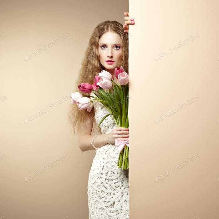 Portrait beautiful woman with bouquet of flowers