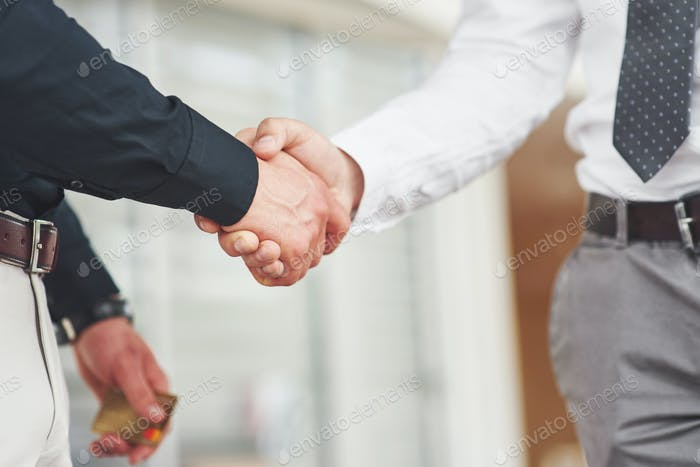 Handshake of two men. Successful business contacts after a good deal