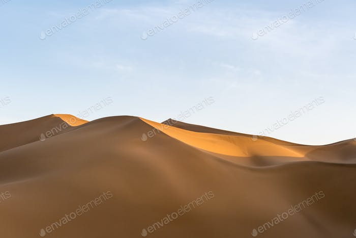 sand dunes illuminated by the setting sun, beautiful desert landscape
