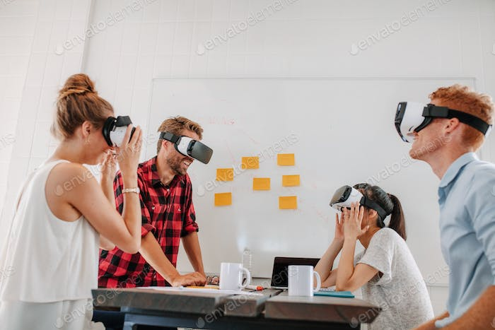 Business team using virtual reality headset in meeting
