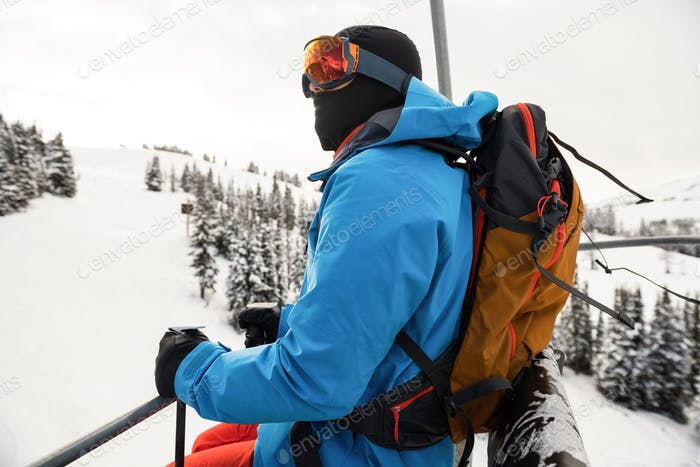 Skier looking at beautiful snow-covered mountains
