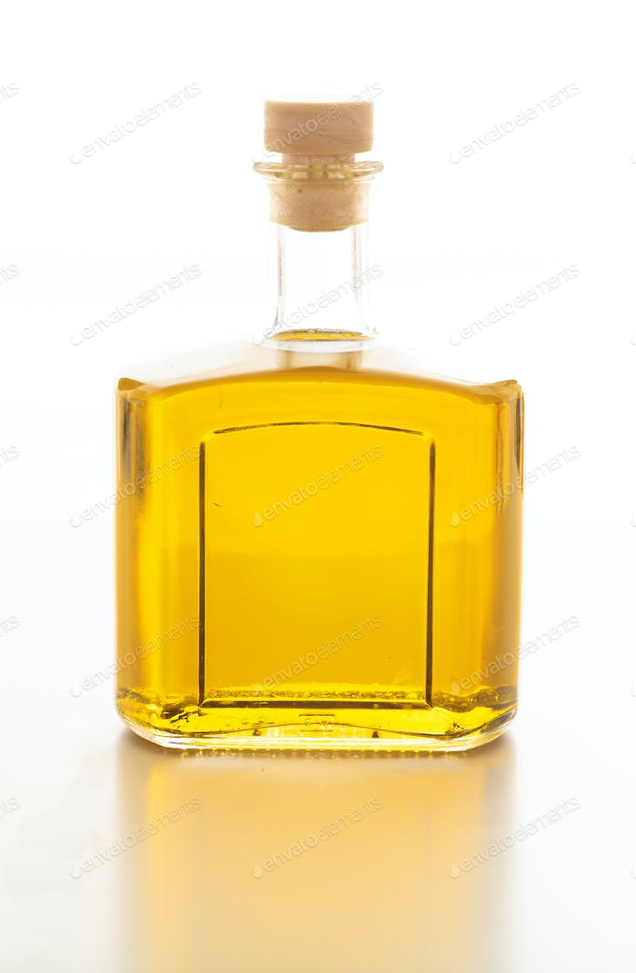 Olive oil bottled isolated against white background.