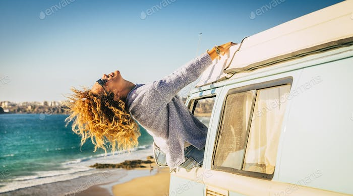 Travel woman with minivan and enjoy summer holiday vacation and lifestyle - female people