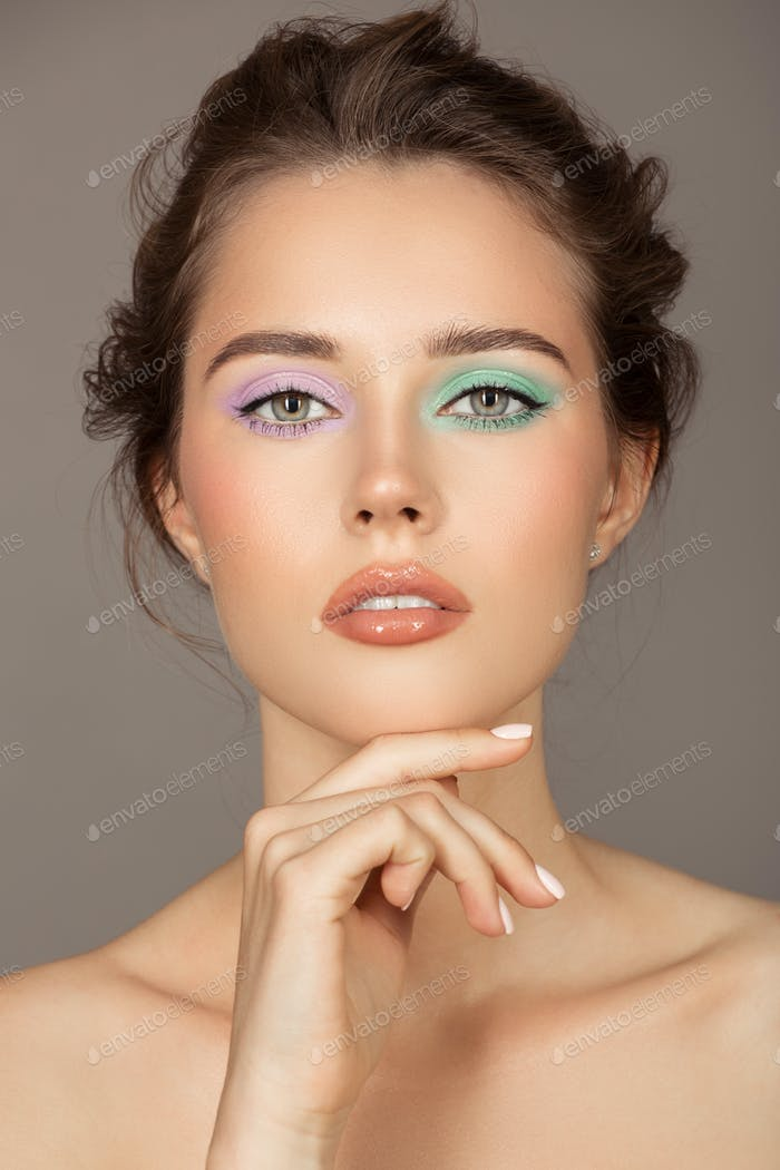 Fashion Portrait Of Young Woman. Colorful Eye Shadows.