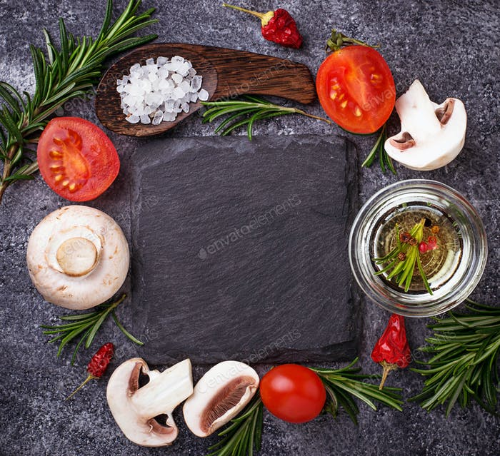 Mushrooms, tomatoes, rosemary, salt and oil. Food background