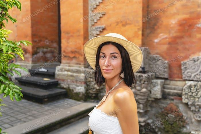 Happy woman travelling through asia stock photo
