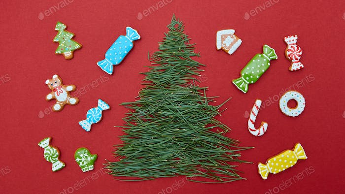 Christmas card with pine needles and cookies