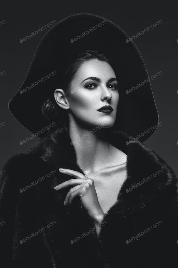 Beautiful girl in fur coat and hat
