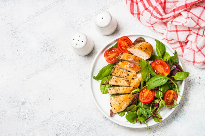 Chicken fillet with salad top view