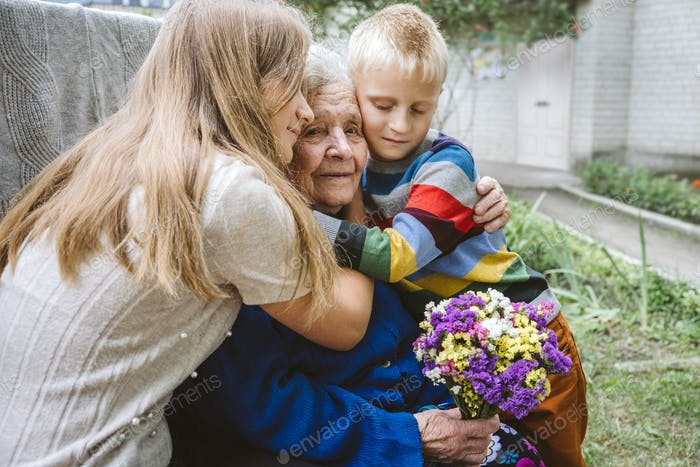 Family groups, multigenerational households, great-grandmother and great-grandchildren. Candid