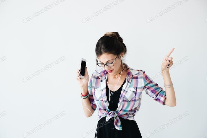 Girl dancing and enjoying music