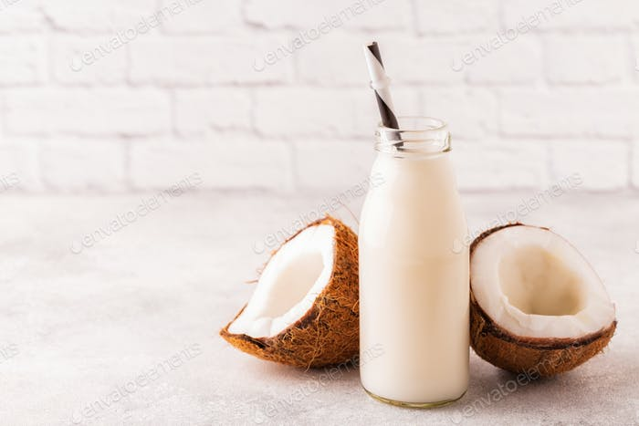 A bottle of coconut milk and coconut