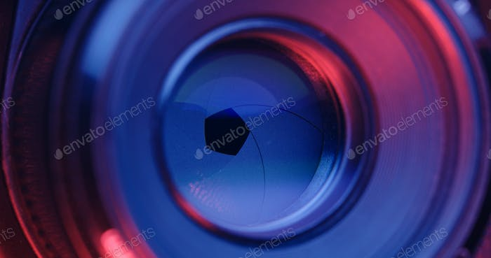 Adjusting Camera lens aperture with pink and purple light