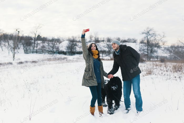 Modern carefree man and woman making selfie with their fluffy do