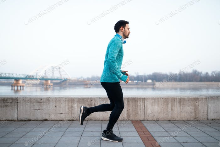 Sportsman in outfit running and jogging