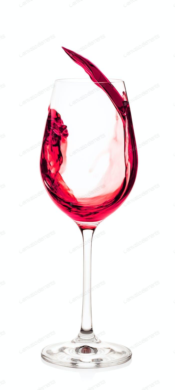Splash of red wine in glass
