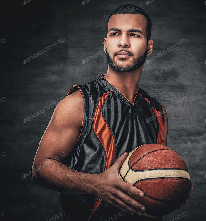 Portrait of Black basketball player with ball