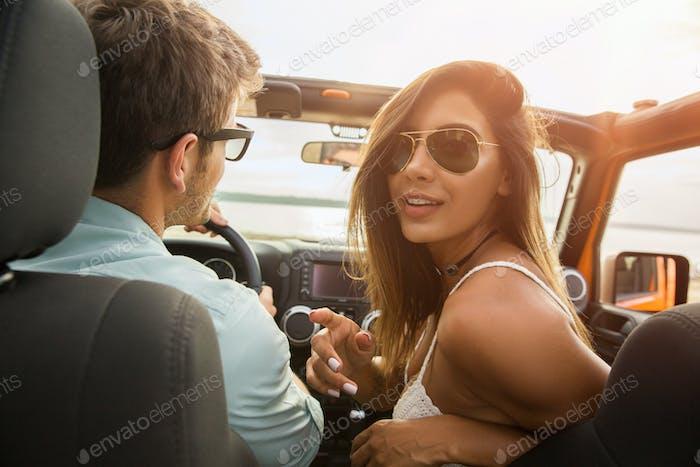 Joyful young couple smiling