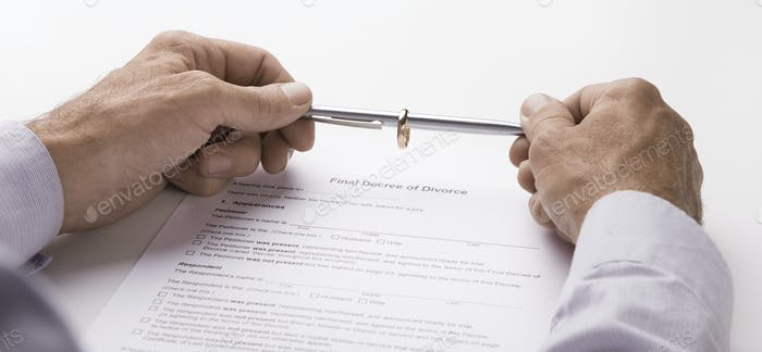 Husband signing decree of divorce, dissolution, canceling marriage