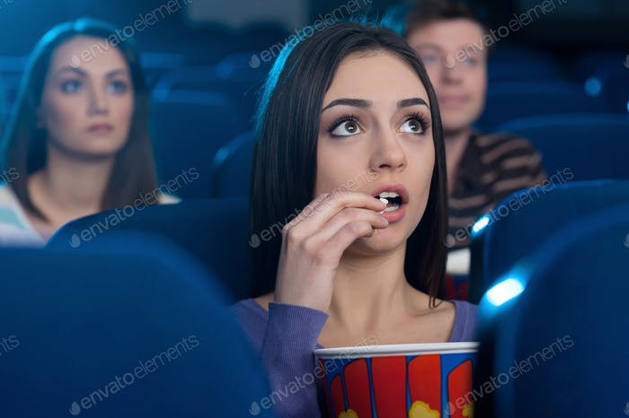 Woman at the cinema.