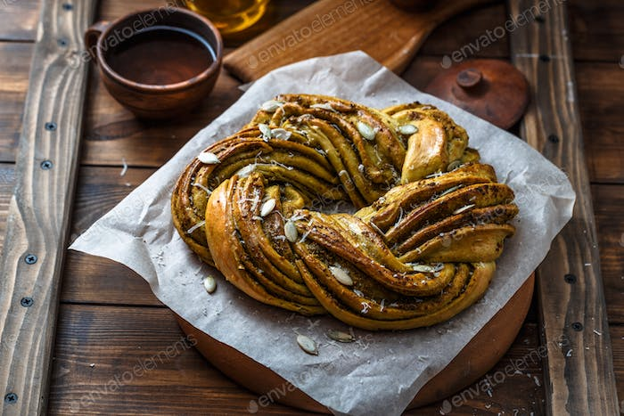 Close view of Babka Brioche Wreath with Pesto and Parmesan