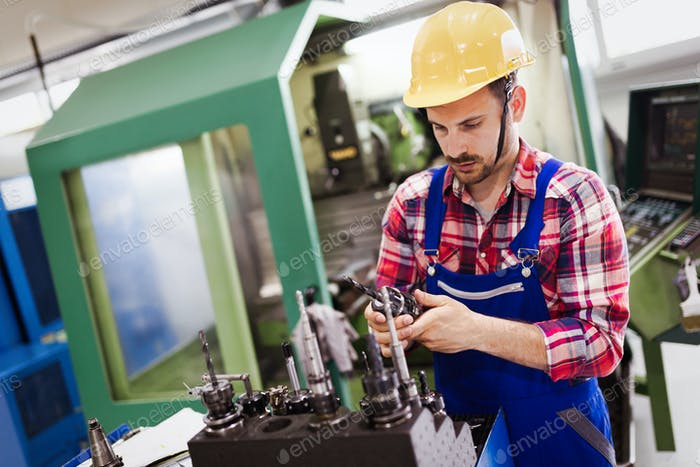modern industrial machine operator working in factory