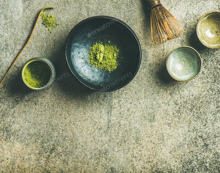 Japanese tools for brewing matcha green tea, grey concrete background
