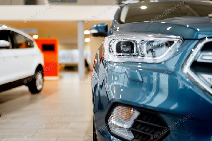 Car dealership, closeup view on vehicle headlight