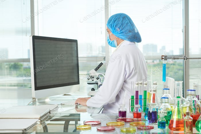 Female Researcher Working at Modern Lab