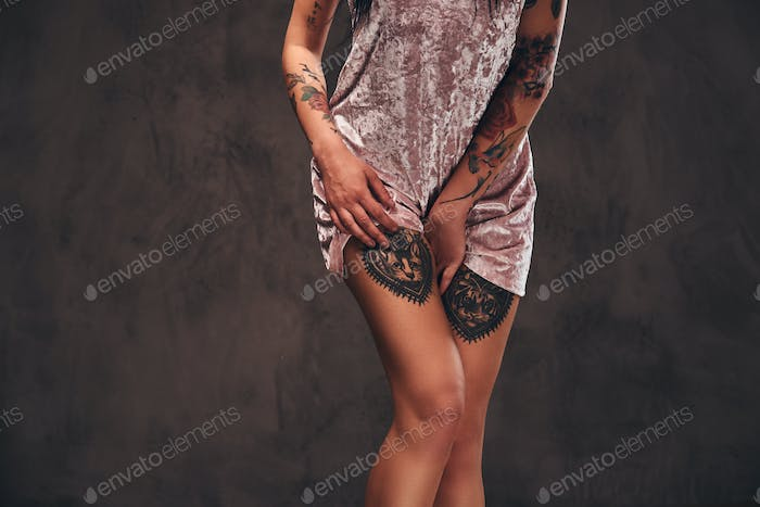 Cropped photo of a tattooed girl wearing a nightgown